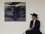 Painter Georgia O'Keeffe Sits before Her Vision of 'Black Place Iii' Photographic Print by George F. Mobley