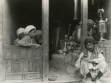 Afghan Men Relaxing at a Bazaar Photographic Print by Maynard Owen Williams