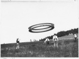A Wheel-Shaped Kite Flies as its Inventor, Alexander G Bell, Watches Photographic Print by Dr. Gilbert H. Grosvenor