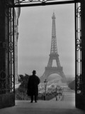 Man Looking Out on the Eiffel Tower Photographic Print by Clifton R. Adams