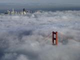 A Glowing Tower of the Golden Gate Bridge Rises Above the Fog Photographic Print by James A. Sugar