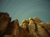 Star Streaks over Sandstone Formations Photographic Print by Bruce Dale