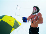 An Expedition Member Scrubs with Snow as  His Daily Bathing Routine Photographic Print by Gordon Wiltsie