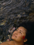 A Cherokee Teacher Immerses Herself in the Oconaluftee River Photographic Print by Maggie Steber