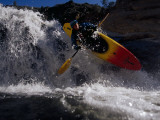 Suspended in Mid-Air, a Kayaker Sails Sideways Down a Short Waterfall Photographie par Barry Tessman
