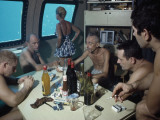 The Cousteaus and their Crew Relax in a Submersible after Work Photographic Print by Robert B. Goodman