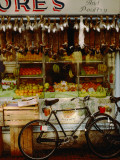 Rabbits Hang  over a Display of Fresh Fruits at a Village Grocery Photographic Print by Annie Griffiths
