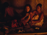 A Topless Tahitian Dancer Is Annointed with Coconut Oil by Firelight Photographic Print by Gordon Gahan