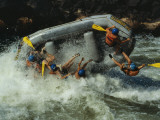 Class V Rapids Flip a Raft Full of Whitewater Enthusiasts Photographic Print by Chris Johns