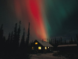 The Aurora Borealis Colors the Sky over a Residence Photographic Print by Michael S. Quinton