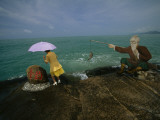 A Tourist Approaches China&#39;s Southernmost Point Photographic Print by Michael S. Yamashita