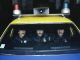 Triplet Policemen in a Police Car Photographic Print by Michael S. Yamashita