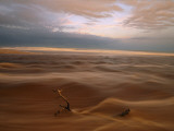 Sun-Burnished Waters from a Lagoon Pour across Sand Flats to the Sea Photographic Print by Michael Nichols