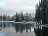 Snowy Landscape with Lake and Evergreen Trees Casting Reflections Photographic Print by Celeste Ingraham