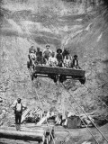 A Group of Miners Rides the Cable Car Back and Forth from Work Photographic Print by Gardiner F. Williams