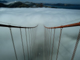 Cables of the Golden Gate Bridge Above the Early Morning Fog Photographie par Randy Olson