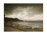 As a Storm Approaches, Empty Rowboats Lay on the Shore Photographic Print by Maynard Owen Williams
