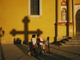 A Family Comes to Worship at the San Cristobal Church Photographic Print by Tomasz Tomaszewski
