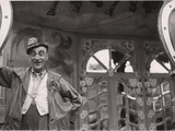 A Clown at the Gingerbread Fair at the Place De La Nation Photographic Print by Maynard Owen Williams
