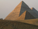 Camel Riders are Dwarfed by the Pyramids of Giza Photographic Print by James L. Stanfield