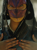 A Bedouin Girl Wearing Saffron on Her Face to Give it a Yellow Cast Photographic Print by James L. Stanfield
