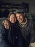 Smiles Crease the Faces of a Romanian Couple Lámina fotográfica por Winfield Parks