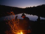 Men and Dogs Sit by a Campfire in New York's Adirondack Mountains Photographic Print by Sam Abell