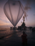 A Naval Hot-Air Balloon Tugs at its Launch Pad on the USS Antietam Photographie par Walter Meayers Edwards