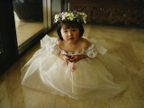A Young Girl Attends a Wedding Photographic Print by Sisse Brimberg