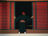 An Okinawan Slides a Door Closed Photographic Print by Karen Kasmauski