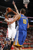 Golden State Warriors v Houston Rockets: Chuck Hayes and Andris Biedrins Photographic Print by Bill Baptist