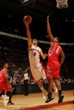 Houston Rockets v Toronto Raptors: Jose Calderon and Chuck Hayes Photographic Print by Ron Turenne
