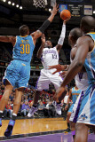 New Orleans Hornets v Sacramento Kings: Tyreke Evans and David West Photographic Print by Rocky Widner