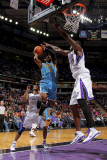 New Orleans Hornets v Sacramento Kings: Chris Paul and Samuel Dalembert Photographic Print by Rocky Widner