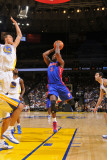 Detroit Pistons v Golden State Warriors: Rodney Stuckey and  Andris Biedrins Photographic Print by Rocky Widner