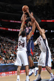 Atlanta Hawks v New Jersey Nets: Joe Johnson, Devin Harris and Brook Lopez Photographic Print by Jesse D. Garrabrant