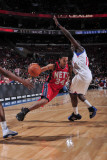 New Jersey Nets v Philadelphia 76ers: Devin Harris and Jrue Holiday Photographic Print by David Dow