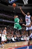 Boston Celtics v Philadelphia 76ers: Rajon Rondo and Jodie Meeks Photographic Print by Jesse D. Garrabrant
