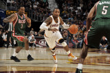Milwaukee Bucks v Cleveland Cavaliers: Mo Williams, Brandon Jennings and Corey Maggette Photographic Print by David Liam Kyle