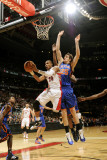New York Knicks v Toronto Raptors: Leandro Barbosa and Timofey Mosgov Photographic Print by Ron Turenne