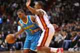 New Orleans Hornets v Miami Heat: Chris Paul and Mario Chalmers Photographic Print by James Riley