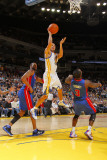 Detroit Pistons v Golden State Warriors: Stephen Curry and  Rodney Stuckey Photographic Print by Rocky Widner