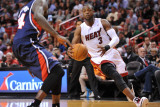 Atlanta Hawks v Miami Heat: Dwyane Wade and Marvin Williams Photographic Print by NBA Photos