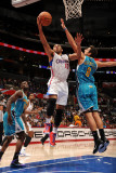 New Orleans Hornets v Los Angeles Clippers: Eric Gordon and Marco Belinelli Photographic Print by Andrew Bernstein