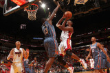 Charlotte Bobcats v Miami Heat: Chris Bosh and Nazr Mohammed Photographic Print by Victor Baldizon