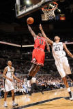 Chicago Bulls v San Antonio Spurs: Ronnie Brewer and Tim Duncan Photographic Print by D. Clarke Evans