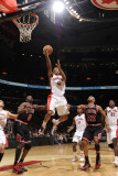 Chicago Bulls v Toronto Raptors: Luol Deng, DeMar DeRozan and Taj Gibson Photographic Print by Ron Turenne