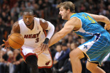 New Orleans Hornets v Miami Heat: Dwyane Wade and Aaron Gray Photographic Print by James Riley