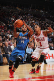 Orlando Magic v Chicago Bulls: Jameer Nelson and Derrick Rose Photographic Print by Gary Dineen