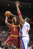 Cleveland Cavaliers v Detroit Pistons: Daniel Gibson and Tracy McGrady Photographic Print by Allen Einstein